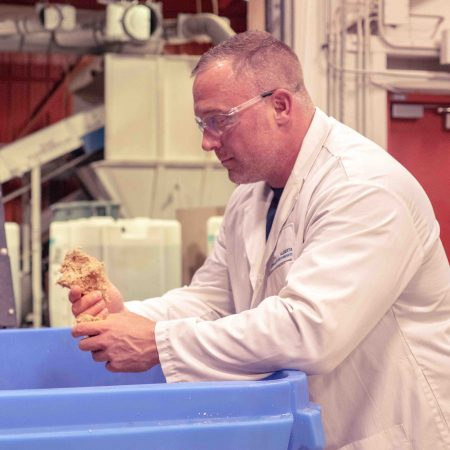 Director of Product Development, Greg Foster inspects the cooked material for consistency of the fibers. (Photo: Province Brands)