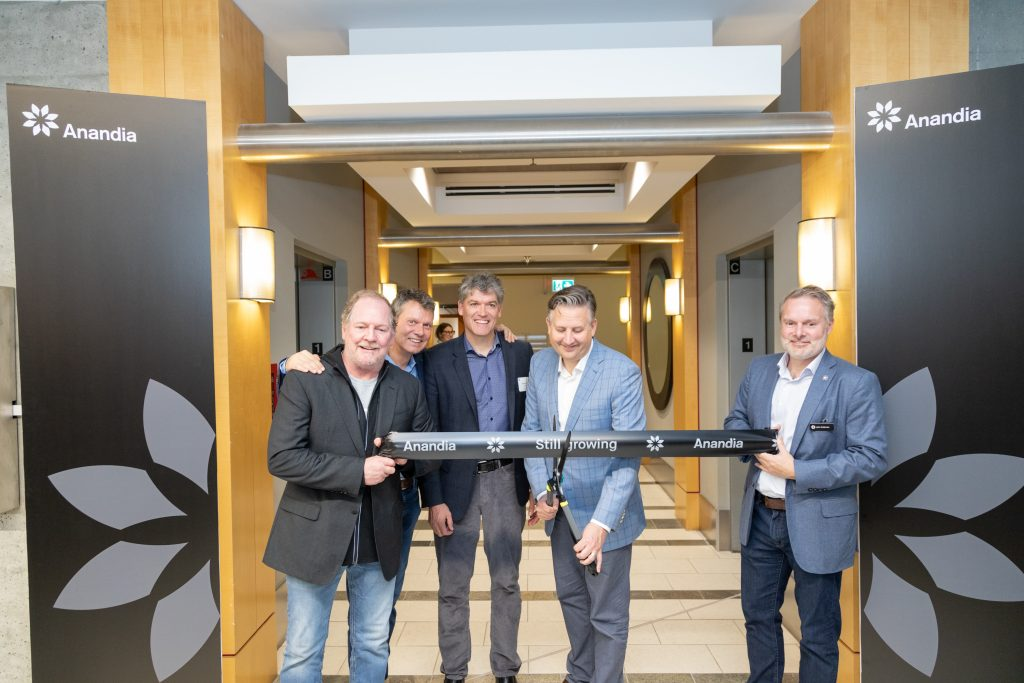 Ribbon cutting ceremony for Anandia's new facility in Vancouver. L to R: Terry Booth, CEO of Aurora Cannabis; Cam Battly, Chief Corporate Office of Aurora Cannabis; Dr. Jonathan Page, Chief Science Officer of Aurora Cannabis and Co-Founder of Anandia Labs; Mayor Kennedy Stewart; Dr. John Coleman, Co-Founder and President of Anandia (Credit: Anandia Laboratories Inc.)